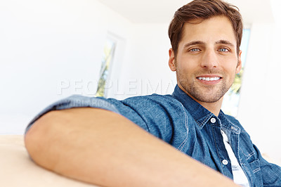 Buy stock photo Handsome young guy relaxing on the sofa at home