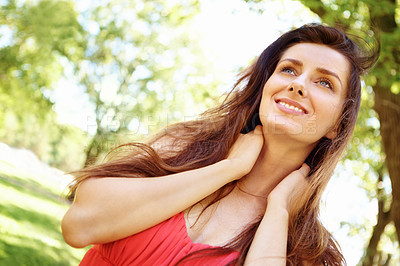Buy stock photo Beautiful brunette looking upwards and enjoying the outdoors with copyspace