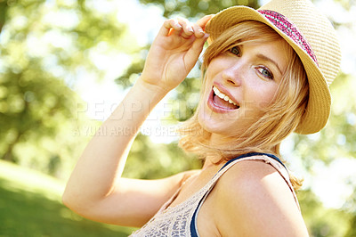 Buy stock photo Portrait of a beautiful young woman wearing a sunhat and posing playfully