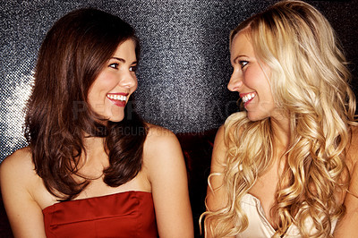 Buy stock photo Two beautiful women looking at each other in a night club