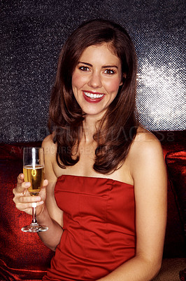 Buy stock photo Portrait of an attractive young woman drinking champagne while sitting in a night club