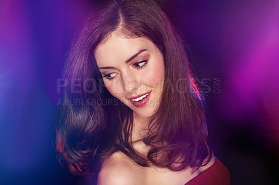 Buy stock photo Head and shoulders shot of an attractive brunette woman surrounded by atmospheric lights