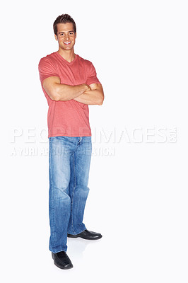 Buy stock photo Full length studio portrait of a handsome young man standing with his arms folded