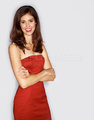 Buy stock photo Studio portrait of an attractive woman dressed in a red cocktail dress