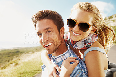 Buy stock photo Portrait of an affectionate young couple enjoying the views while on a roadtrip