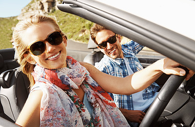 Buy stock photo Portrait of a young woman driving while on a roadtrip with her boyfriend