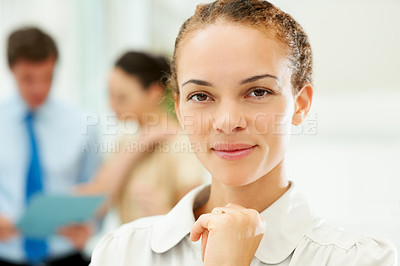 Buy stock photo Closeup of confident female executive with people discussing in background