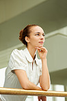 Ambitious businesswoman looking away in thought