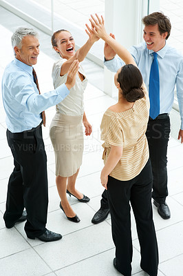 Buy stock photo Group of joyful business people together celebrating their success with a high five
