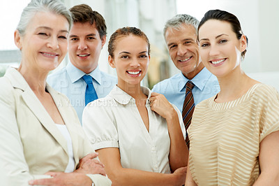 Buy stock photo Portrait of a group of successful business people standing together smiling
