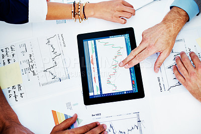 Buy stock photo High-angle cropped view of businesspeople working together on a digital tablet