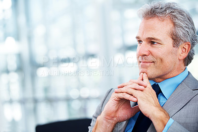Buy stock photo A mature businessman thinking while sitting in his office