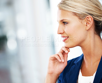 Buy stock photo A gorgeous blonde businesswoman looking straight ahead