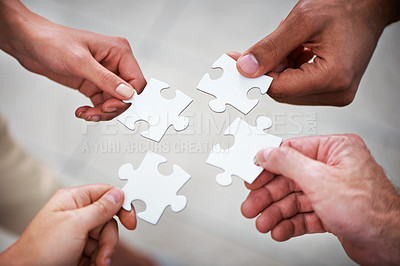 Buy stock photo Closeup of four hands putting puzzle pieces together