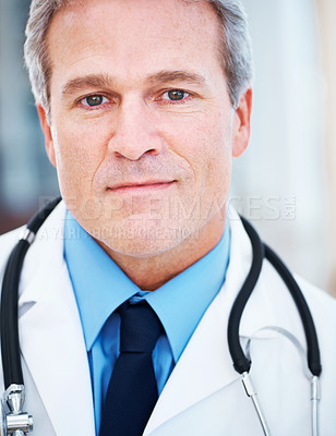 Buy stock photo Closeup of a handsome mature doctor smiling at the camera
