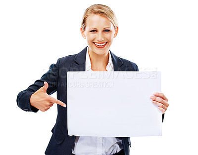 Buy stock photo A gorgeous young businesswoman holding and pointing at a blank placard