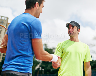 Buy stock photo Shot of two tennis players shaking hands