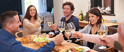 Buy stock photo Cropped shot of a family sharing a meal around the dinner table