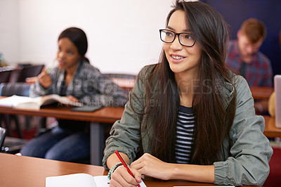 Buy stock photo Shot of a young woman looking up attentively in class