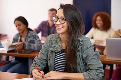 Buy stock photo Shot of a happy student paying attention in class