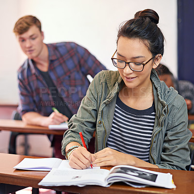 Buy stock photo Shot of a student trying to see another student's work in class
