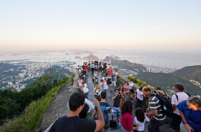 Buy stock photo Shot of tourists taking pictures from a lookout point over Rio