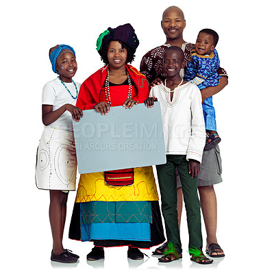 Buy stock photo Studio shot of a traditional african family holding a blank board, isolated on white