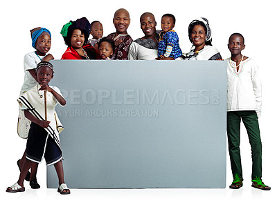 Buy stock photo Studio shot of a large african family holding a blank board, isolated on white