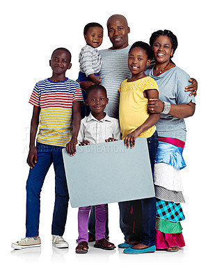 Buy stock photo Studio shot of a happy african family holding a blank board, isolated on white