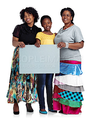 Buy stock photo Studio shot of two african women with a teenage girl holding a blank board