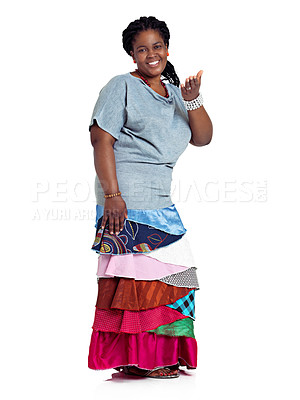 Buy stock photo Studio portrait of an african woman dressed in a traditional style skirt, isolated on white
