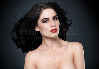 Buy stock photo Portrait of a beautiful young woman posing against a black background