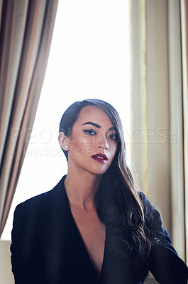 Buy stock photo Shot of a woman in a luxurious setting wearing classicly elegant attire