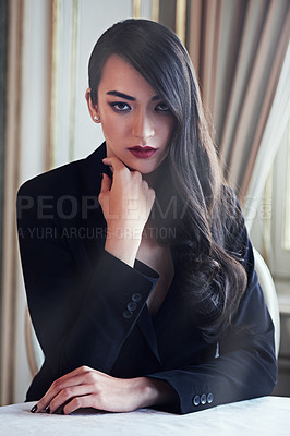 Buy stock photo Portrait shot of an attractive and elegant young woman looking seriously at the camera