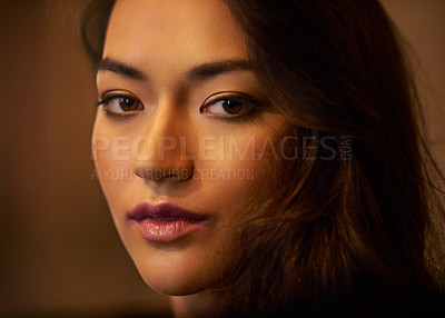 Buy stock photo Closeup portrait of a gorgeous young woman's face in beautiful lighting