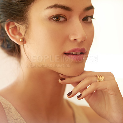 Buy stock photo Closeup portrait of a beautiful young woman dressed elegantly in gold