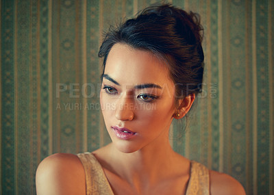 Buy stock photo Shot of a beautiful young woman posing against a patterned green background