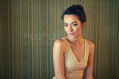 Buy stock photo Portrait of a beautiful young woman dressed elegantly in a wallpapered room