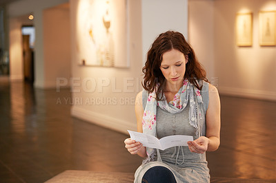 Buy stock photo Shot of a young woman enjoying a day in a gallery