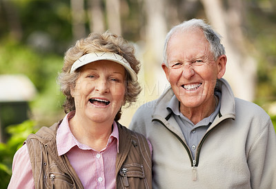 Buy stock photo Portrait of a cheerful mature couple enjoying together in park