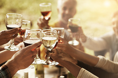 Buy stock photo Closeup shot of  wine glasses being held together to say cheers