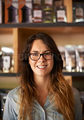 Buy stock photo Cropped portrait of a beautiful young woman wearing spectacles in a store