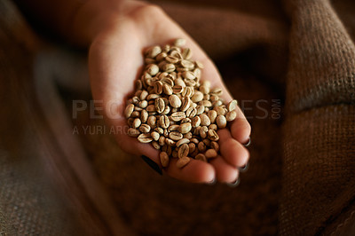 Buy stock photo Closeup of a handful of fresh raw coffee beans