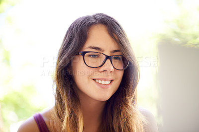 Buy stock photo Shot of a beautiful young woman looking at her laptop screen outside