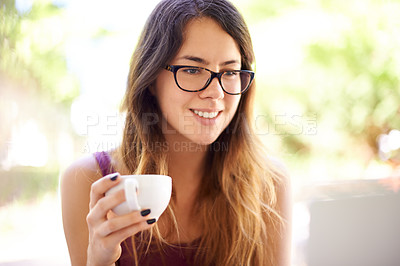 Buy stock photo Shot of a beautiful young woman having a cup ofcoffee outside