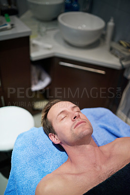 Buy stock photo Shot of a man lying on a table in a beauty clinic