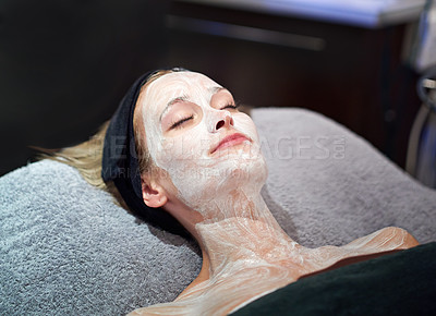 Buy stock photo A young woman getting a facial at a spa