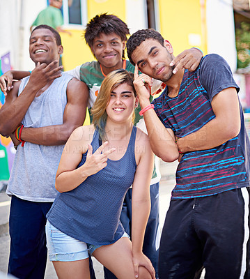 Buy stock photo Portrait of a group of teenagers standing in the streets of Brazil