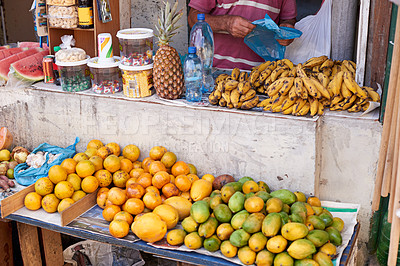 Buy stock photo Cropped shot of a street vendor selling food at his market stall