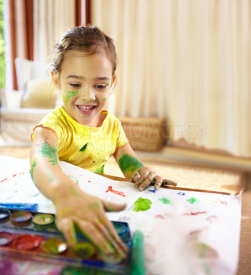 Buy stock photo Shot of an adorable little girl making a mess while painting